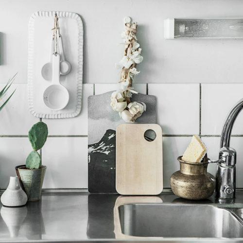 A macramé curtain and kitchen details
